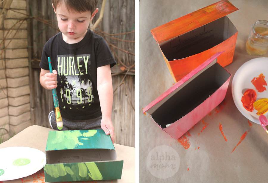 boy painting his cereal box into a Valentine Mailbox