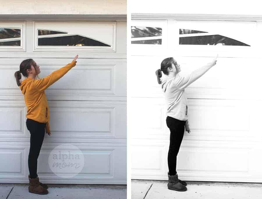 Girl posing to imitate Banksy's Girl and Balloon Art