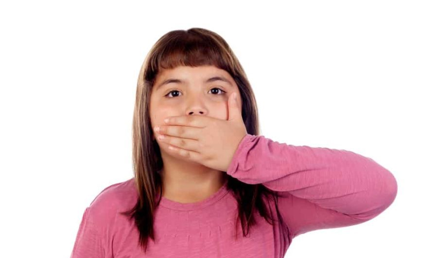 Little girl with eleven years old covering her mouth and fearful of swallowing medication