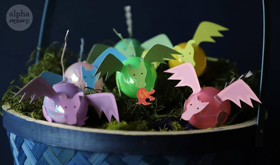 Easter basket filled with plastic eggs made into mini dragons from paper craft