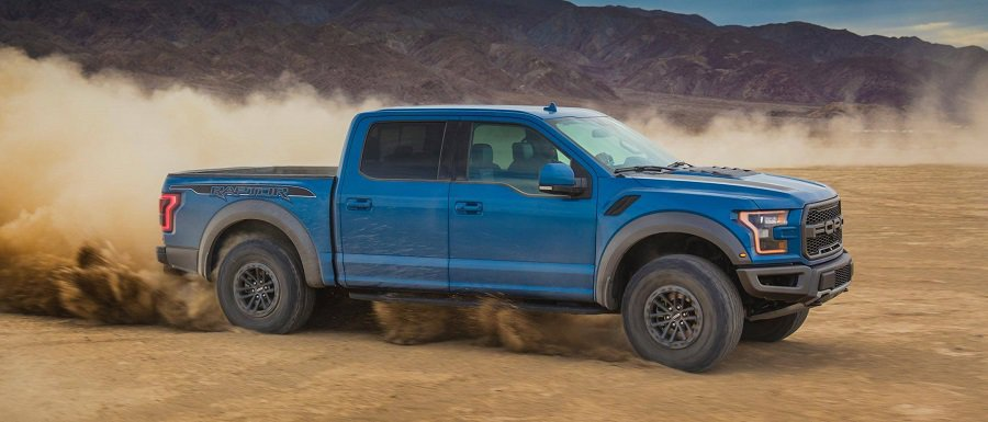 photo of blue 2019 Ford F-150 in motion