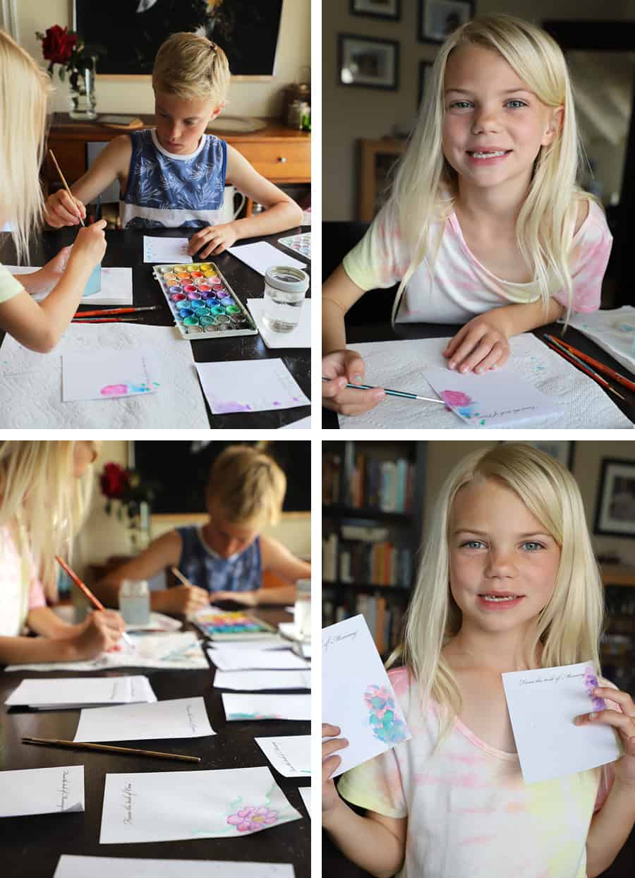 boy and girl using watercolor paints to create a handmade notepad