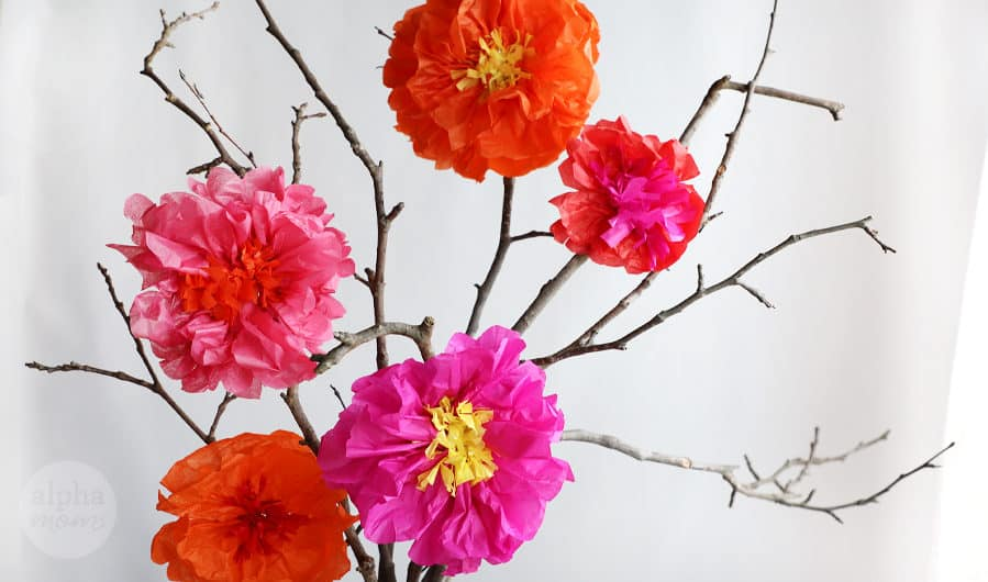 Bouquet of tall branches with handmade hot pink and orange tissue flowers
