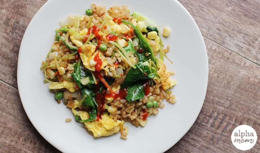 Top view of homemade vegetable fried rice on a white plate