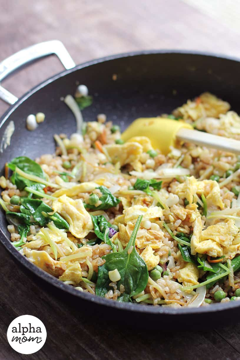 Homemade vegetable fried rice in the skillet with spatula