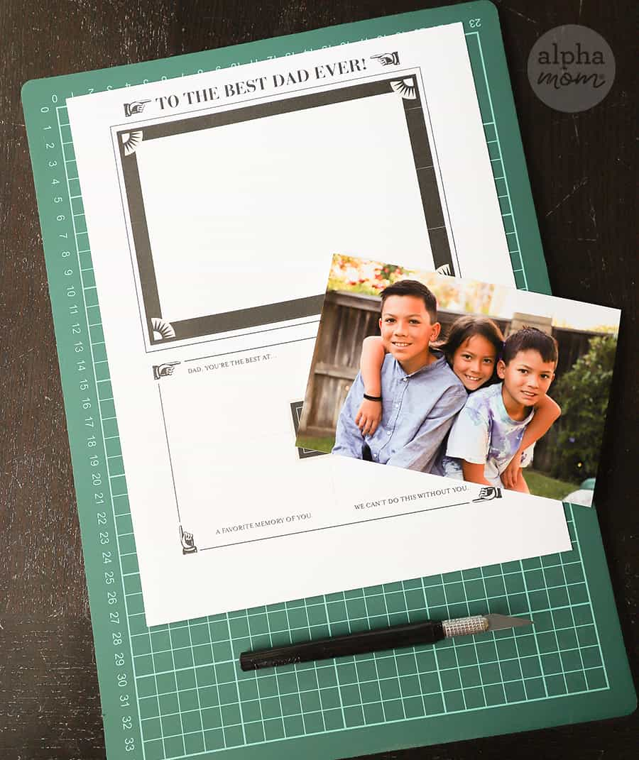 overhead shot Father's Day printable and photo of three kids on self-healing mat