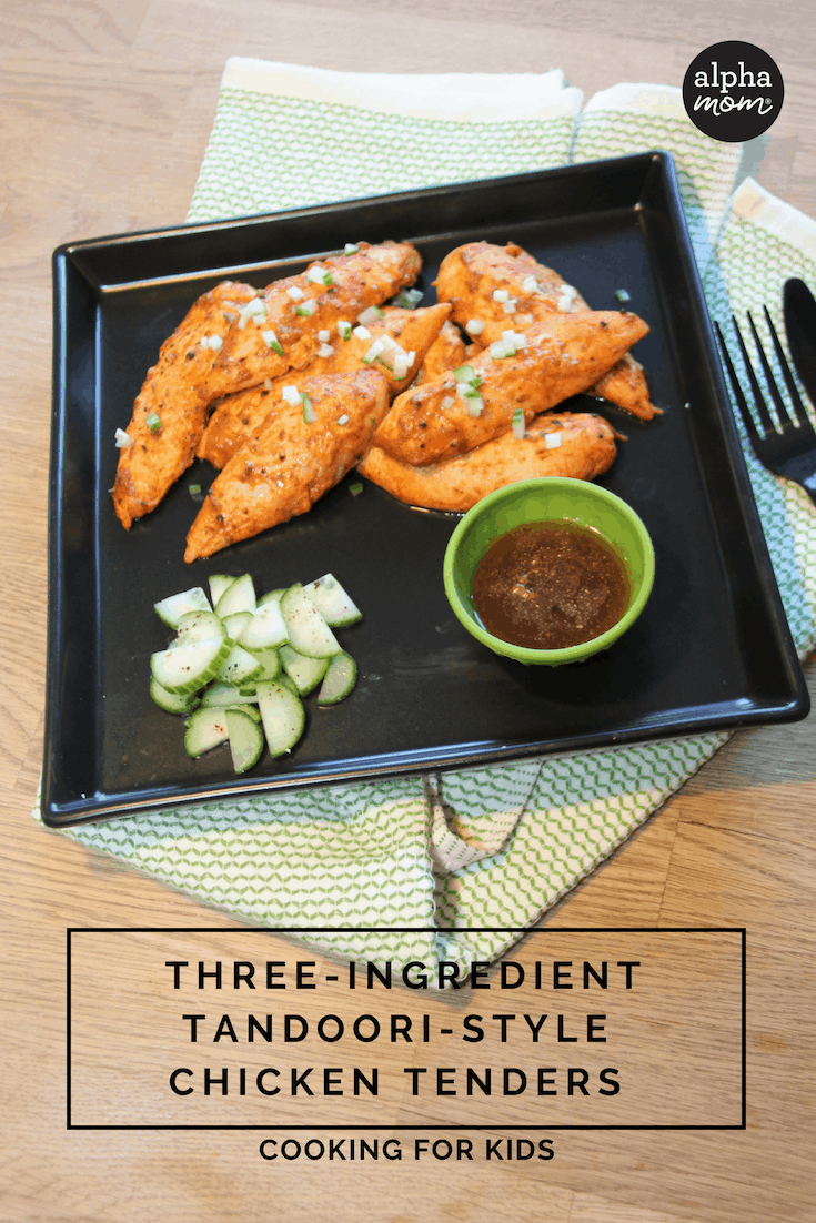 overhead shot of plated Three-Ingredient Tandoori-Style Chicken Tenders with sweet and spicy dipping sauce and cucumber salad