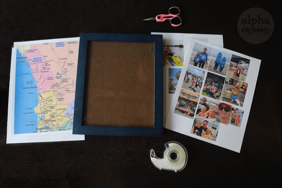overhead photo of supplies such as printed map, empty frame and photos on paper