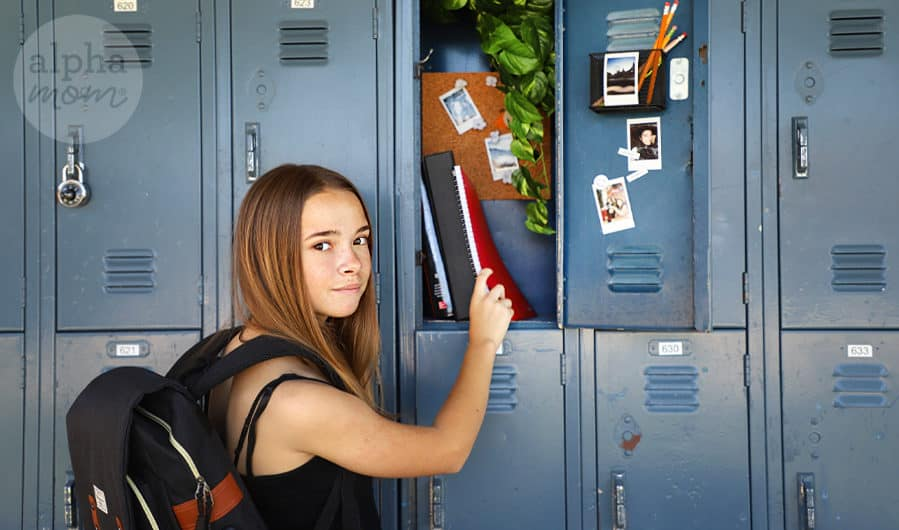 teen girl standing by her decorated school locker