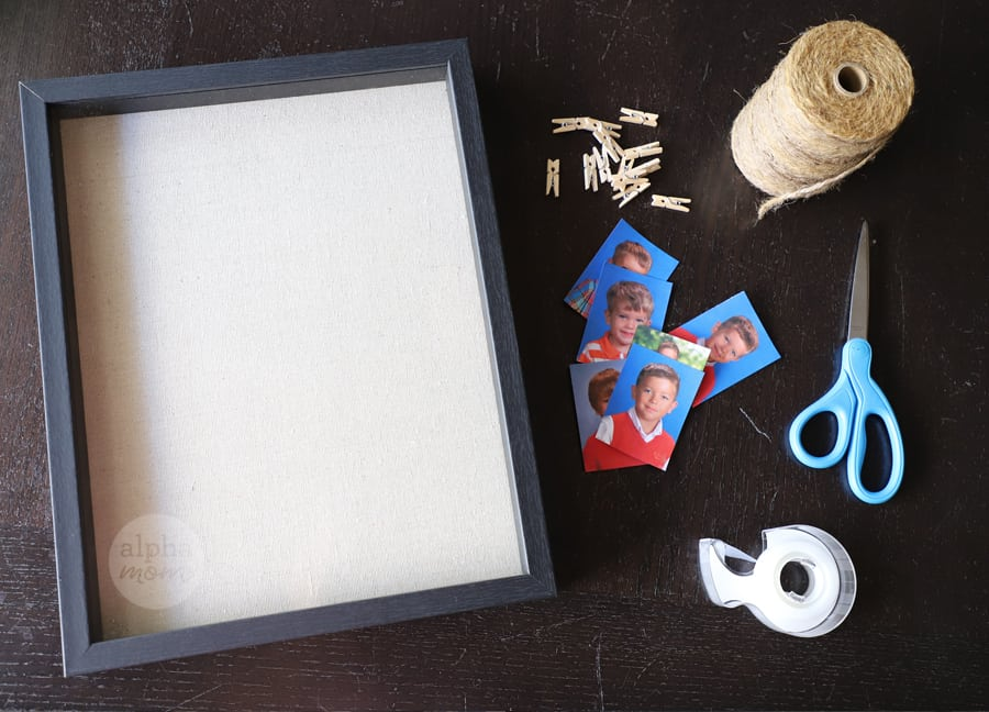 overhead photo of shadowbox frame and supplies to display school portraits