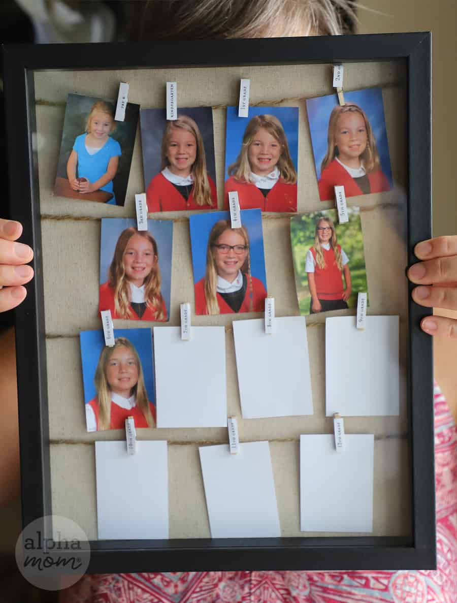 picture of shadowbox frame filled with school portraits over the years