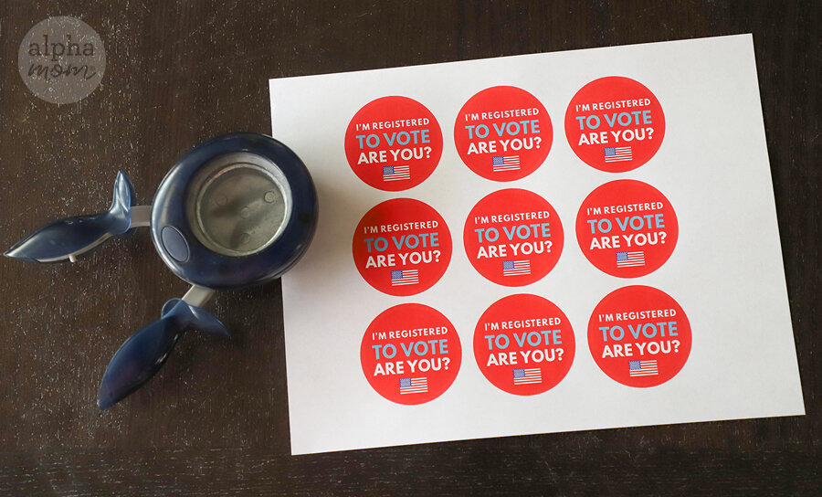 "Overhead picture of ""I'm Registered To Vote, Are You?"" Stickers with 2-inch circle punch"