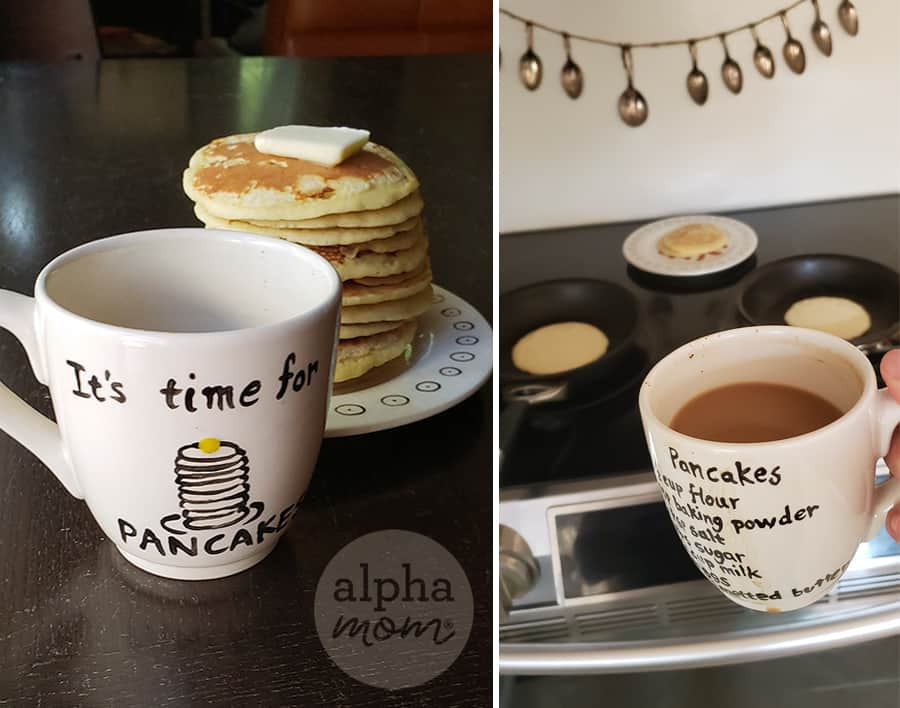 two photos of painted white mug craft with pancake recipe and cartoon on it in foreground and very tall stack of fluffy pancakes on plate in background