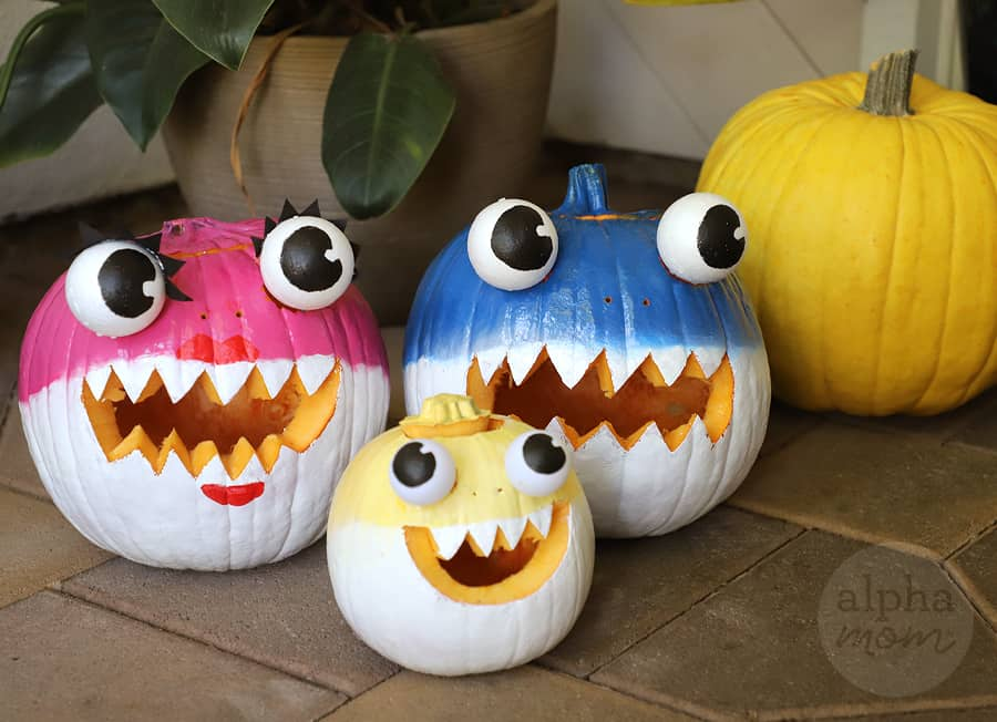 handpainted pink, blue and yellow pumpkins transformed into Mommy, Daddy and Baby Shark jack io'lanterns