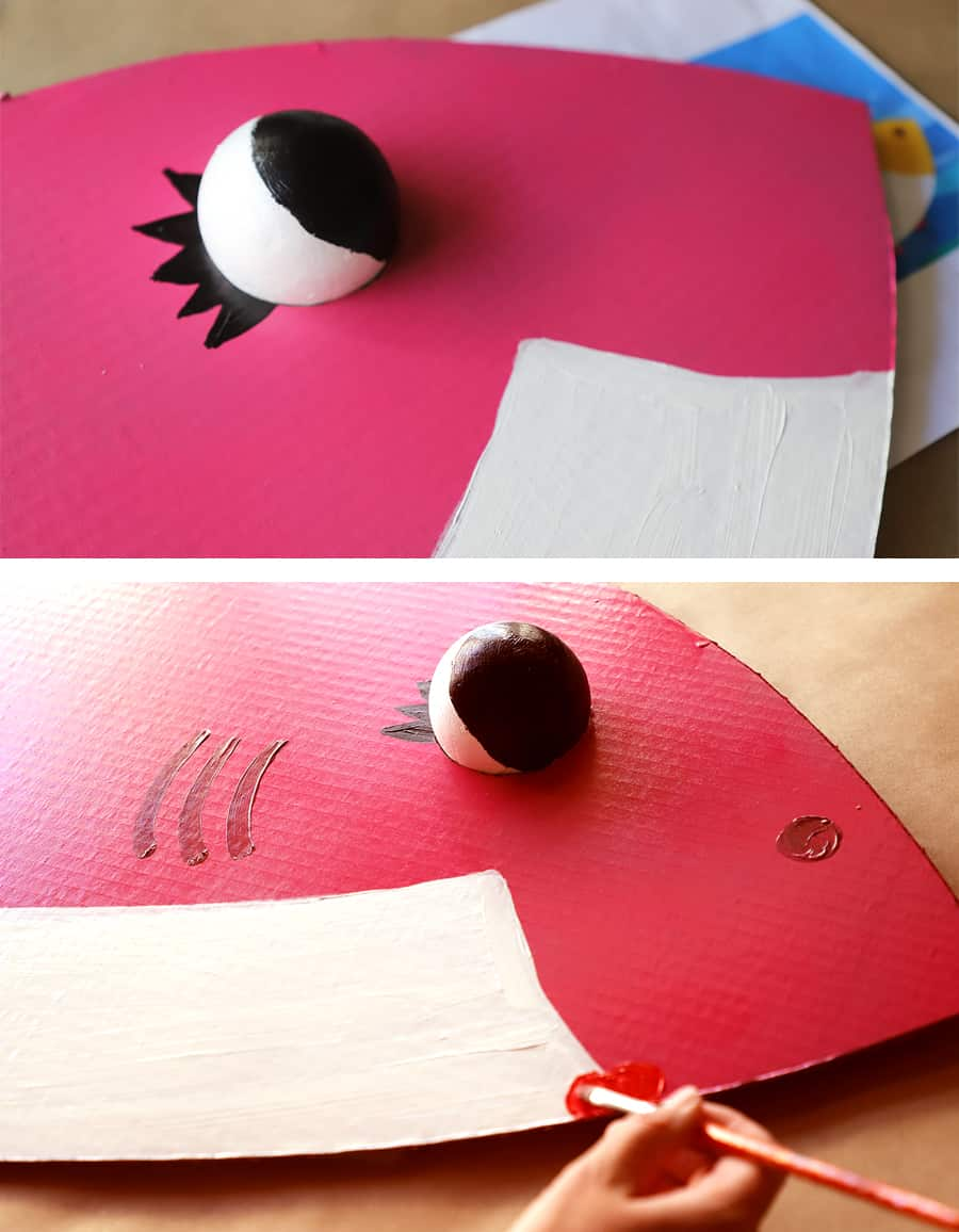 Two photos showing painting details onto Mommy Shark cardboard Halloween costume