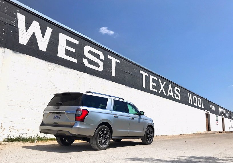 grey Ford Expedition Max SUV in front of a West Texas Wool factory