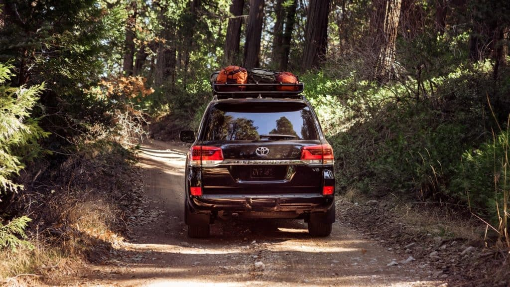 picture of a black Toyota Land Cruiser being driven on rough terrain