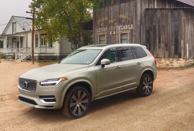 picture of a beige Volvo XC90 SUV parked outside of a stable