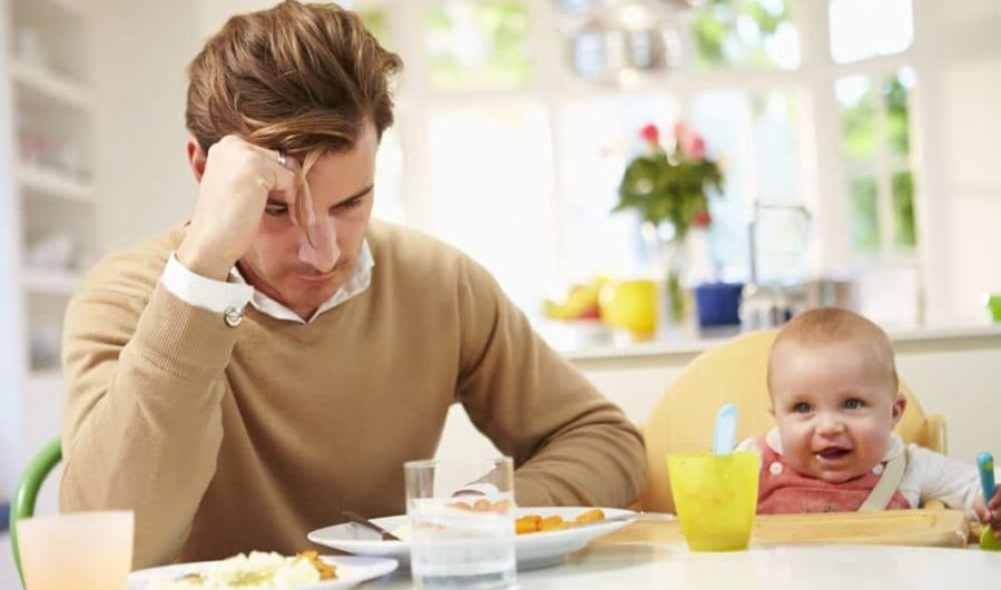 Father Feeling Depressed At Baby's Mealtime