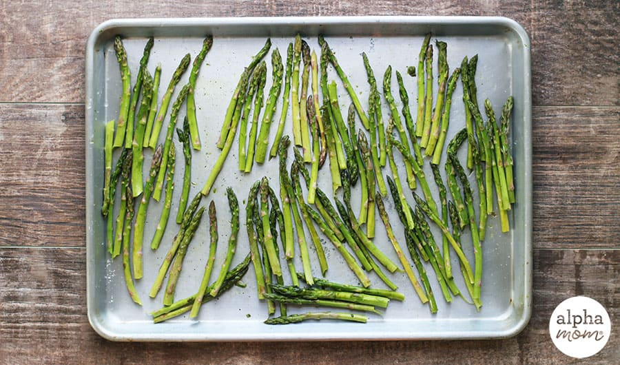 Top view of roasted asparagus on a rimmed baking sheet