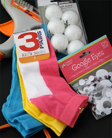 supplies like socks, ping pong balls, and googly eye stickers and glue gun to make craft