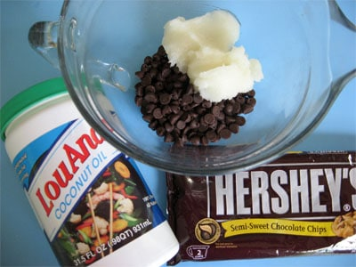close-up of chocolate chips and hardened coconut oil in a glass mixing bowl