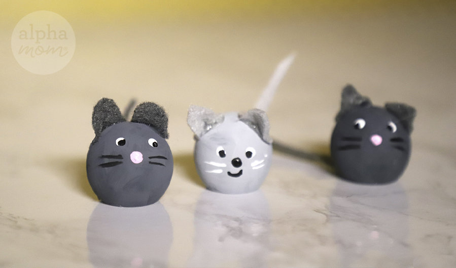 close-up of three painted and crafted wooden mice