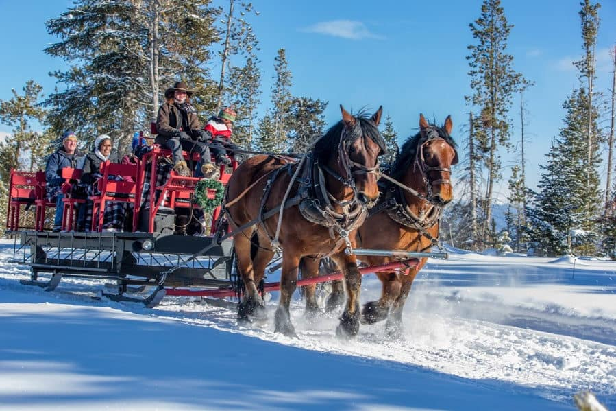 adults on a sleigh ride at Snow Mountain Ranch in Colorado
