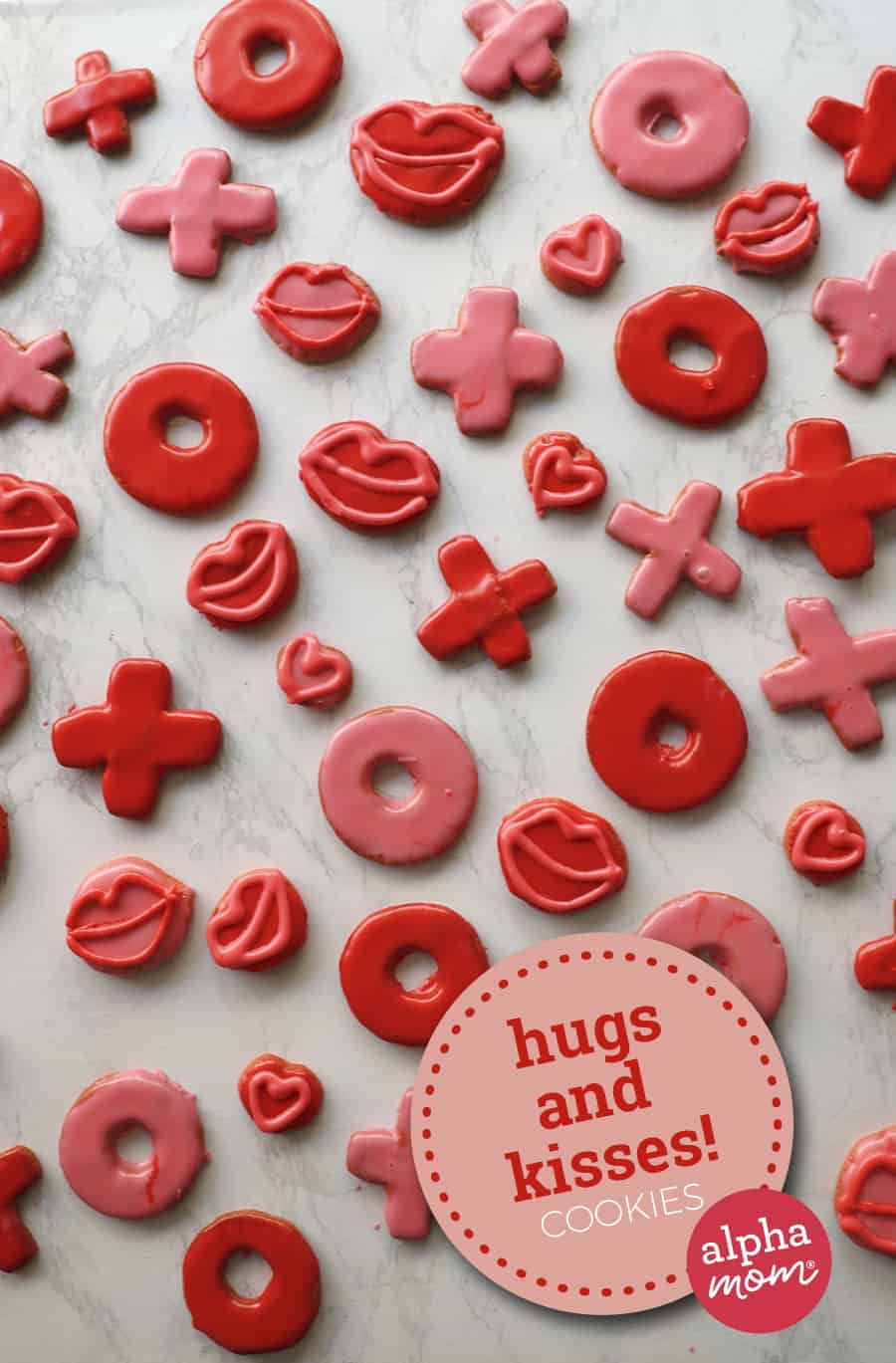overhead photo of red and pink Valentine's Day cookies that are lips and Xs and Os representing hugs and kisses