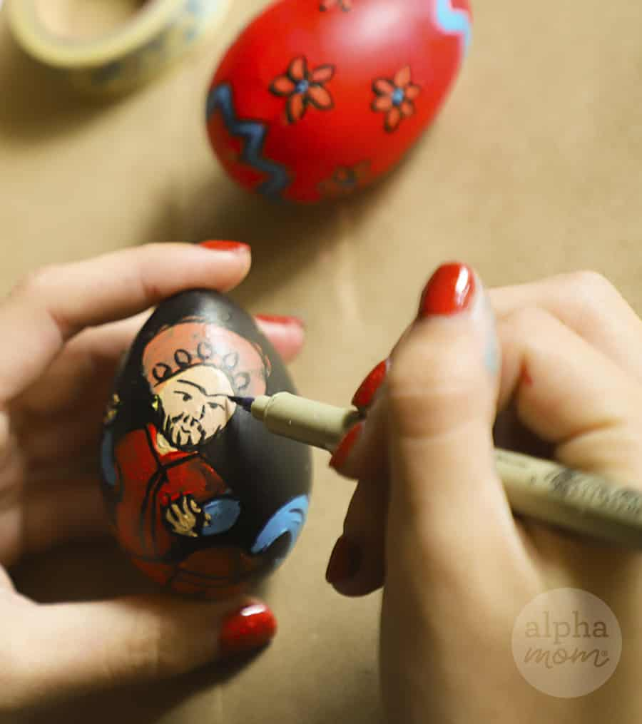 drawing detail onto painted Nowruz egg