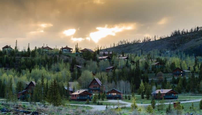cabins in the mountains of Colorado with pretty sky in the background