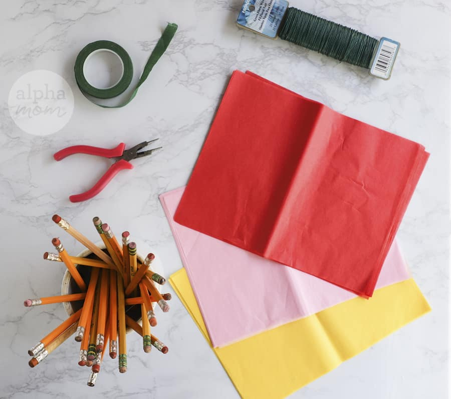 overhead photo of tissue paper and supplies to make paper flowers