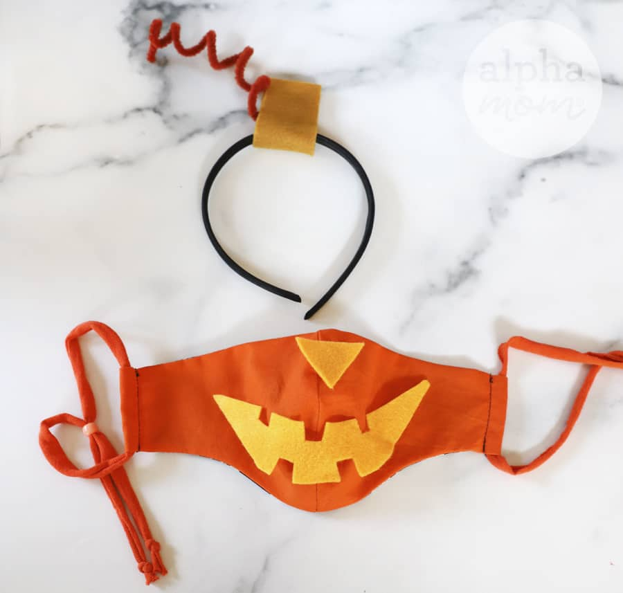 overhead photo of orange face mask with orange felt and headband to to make Jack-o-lantern costume