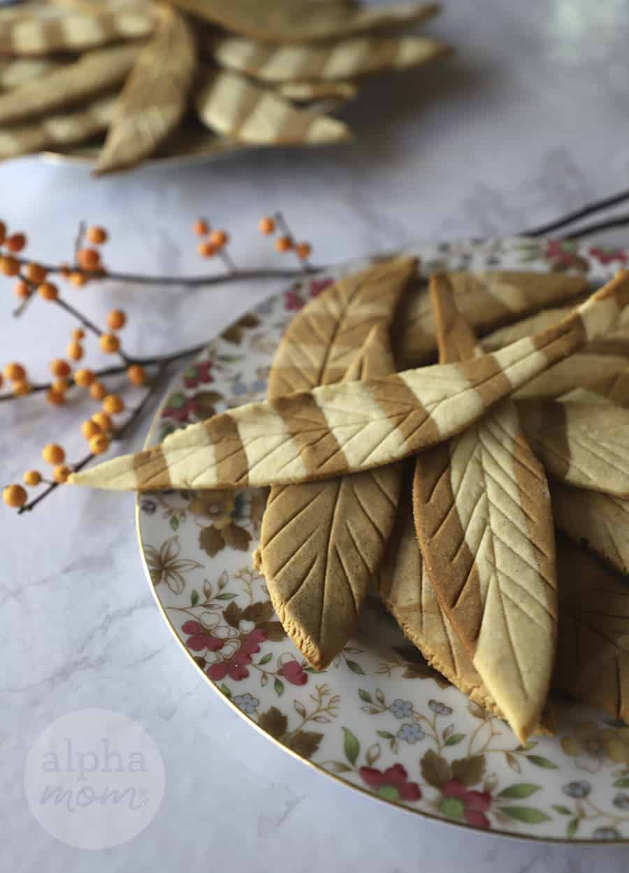 close-up of Feather Sugar Cookies for Thanksgiving on two plates on white tablecloth