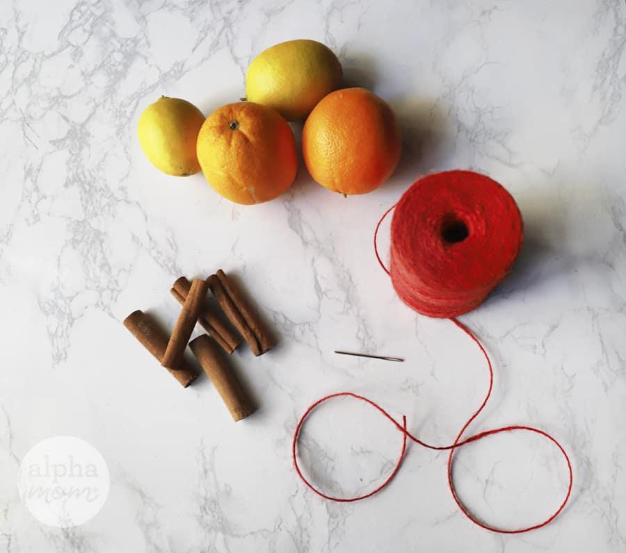 overhead photo of lemons, oranges, cinnamon sticks and twine