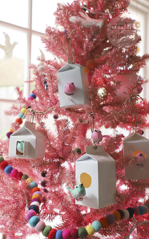 pink Christmas tree with homemade dairy carton birdhouse ornaments