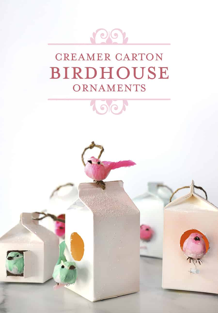 close-up photo of homemade birdhouse ornaments made from creamer cartons