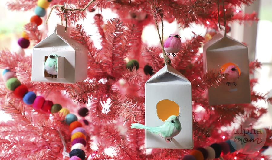 close-up of birdhouse ornaments made from dairy cartons on pink Christmas tree