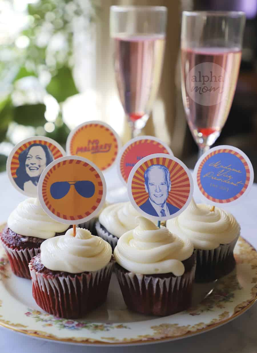 close-up of champagne and plate of cupcakes with variety of photo toppers with graphics of Joe Biden, Kamala Harris, aviators, and Happy Inauguration Day.