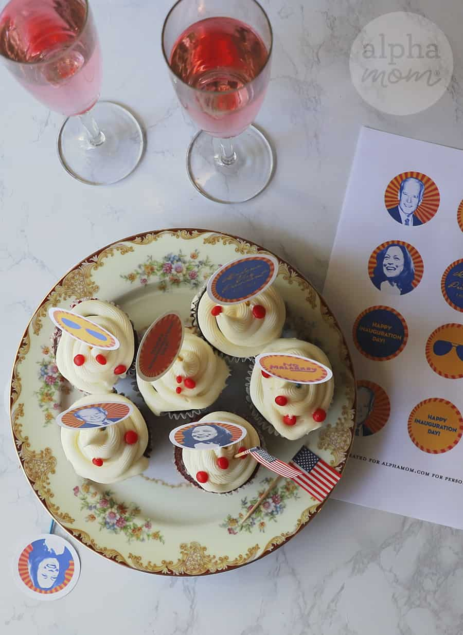 overhead photo of plate with cupcakes with photo toppers of Joe Biden and Kamala Harris and pink champagne