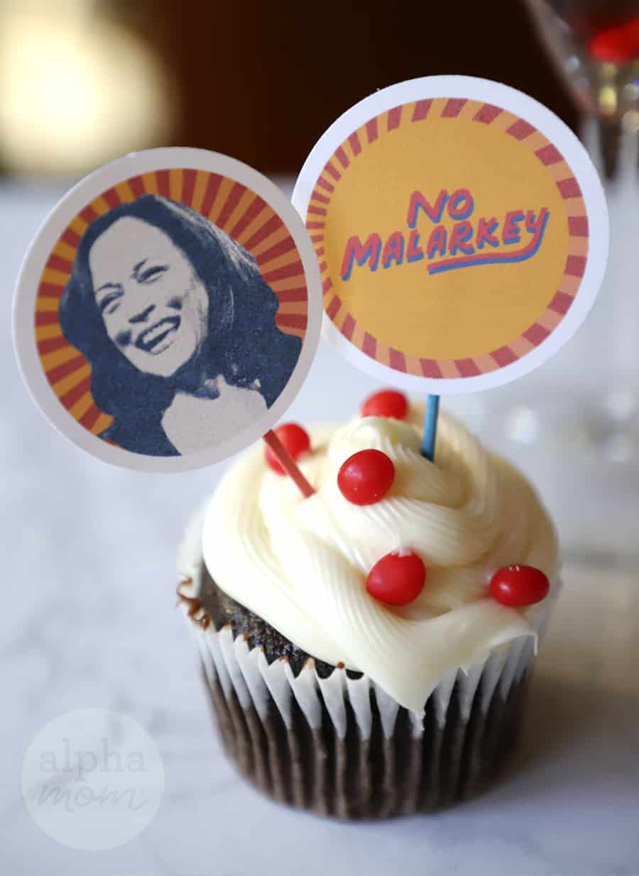 very very close-up photo of cupcake with topper of VP elect Kamala Harris and No Malarkey toppers
