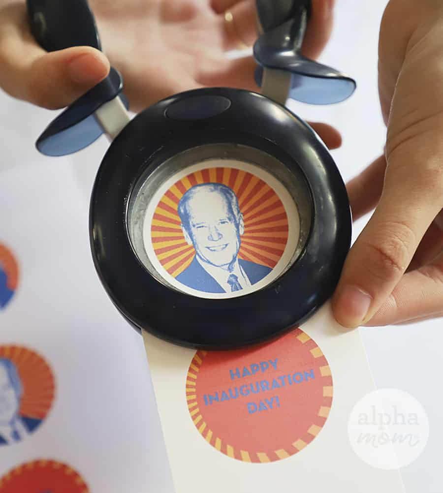 close-up photo of punch hole making cupcake topper of Joe Biden for Inauguration Day Celebration