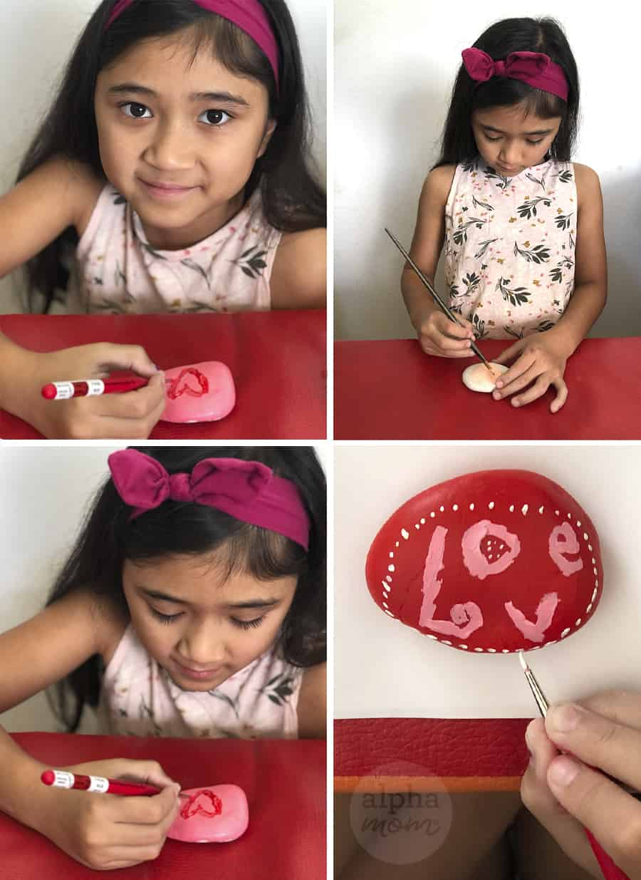 four photos showing a girl with a big red bow in her hair hand painting LOVE and hearts on rocks for Valentine's Day