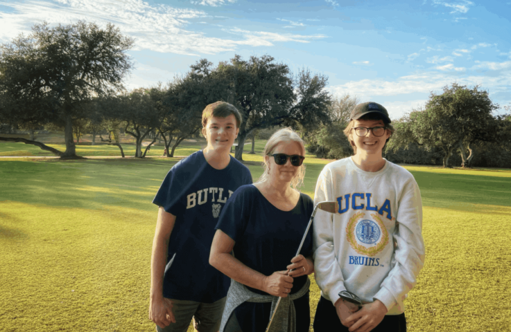 photo of mom and two older teen sons on golf course at the Hyatt Regency Hill Country Resort in San Antonio