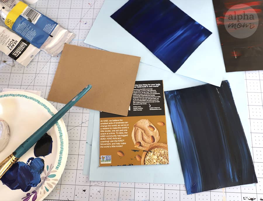 overhead photo of paint supplies and cardboard for crafting