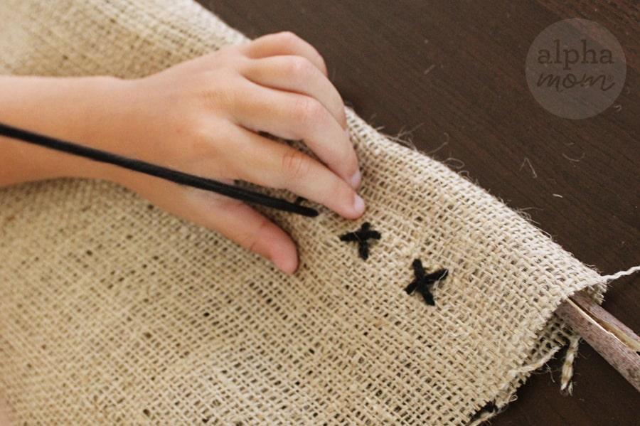 stitching x's in burlap