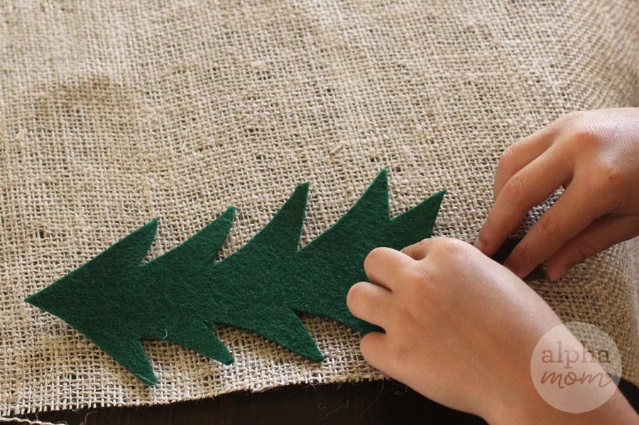 adding felt trees to burlap for craft