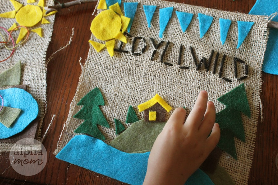 stitching Idyllwild and decorating camp banner with felt
