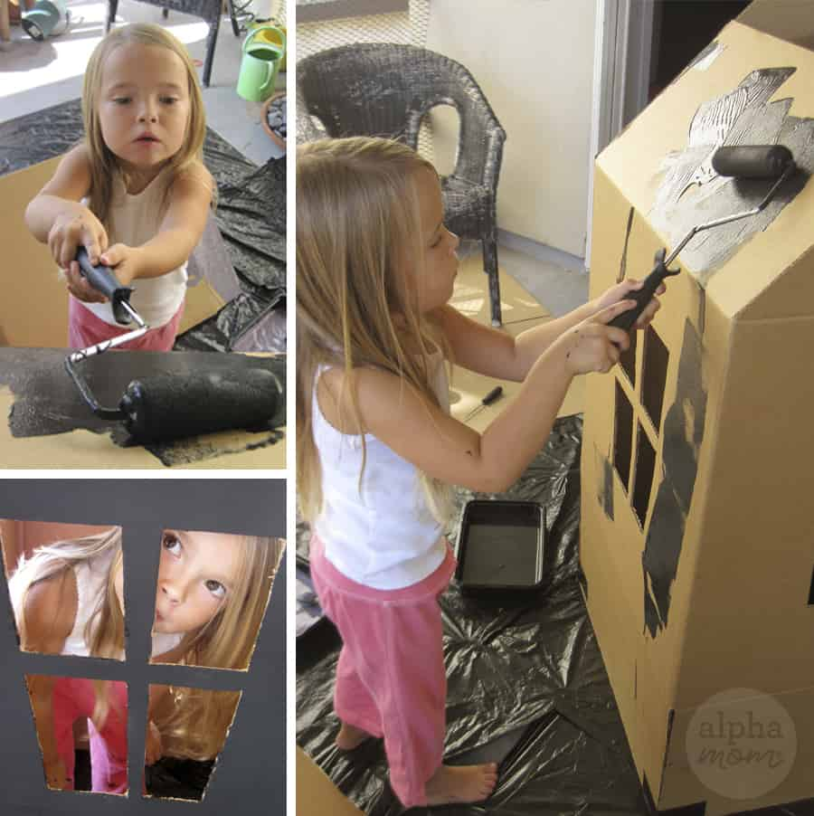 three photos of little blond girl wearing white shirt and pink sweatshirt adding black paint with roller onto cardboard box made into haunted house for Halloween