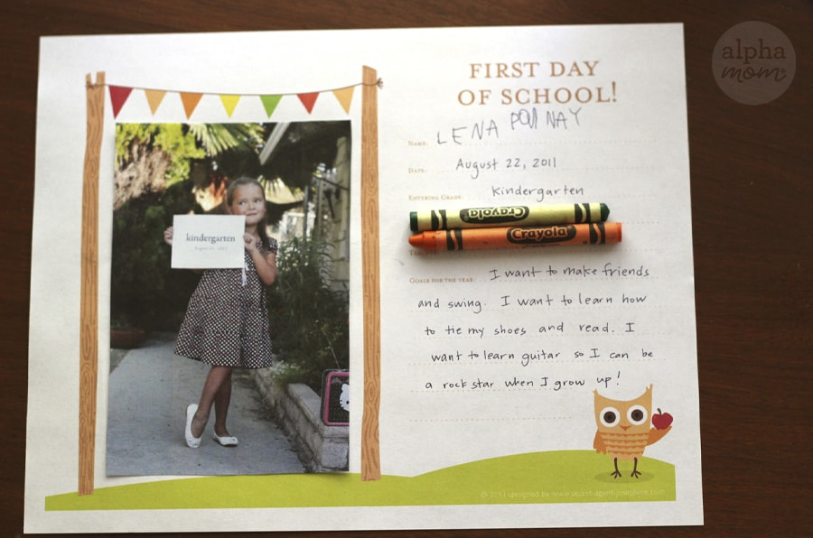 Completed First-Day of School Printable with picture attached and crayons